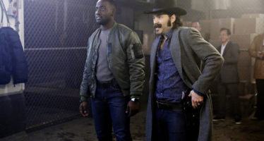 "WYNONNA EARP -- ""Two-Faced Jack"" Episode 108 -- Pictured: (l-r) Shamier Anderson as Agent Dolls, Tim Rozon as Doc Holliday -- (Photo by: Michelle Faye/Syfy/Wynonna Earp Productions)"