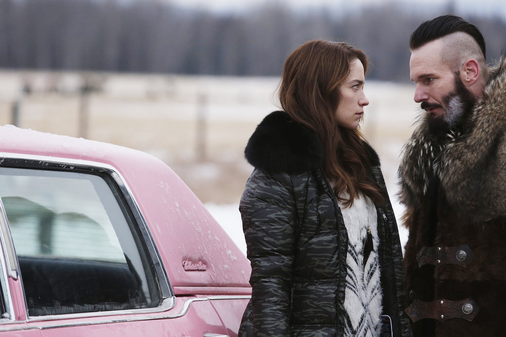 "WYNONNA EARP -- ""Bury Me With My Guns On"" Episode 109 -- Pictured: (l-r) Melanie Scrofano as Wynonna Earp, Michael Eklund as Bobo Del Ray -- (Photo by: Michelle Faye/Syfy/Wynonna Earp Productions)"
