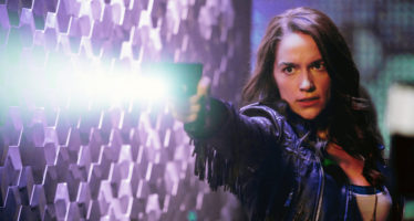 """WYNONNA EARP -- """"Keep the Home Fires Burning"""" Episode 102 -- Pictured: Melanie Scrofano as Wynonna Earp -- (Photo by: Michelle Faye/Syfy/Wynonna Earp Productions)"""