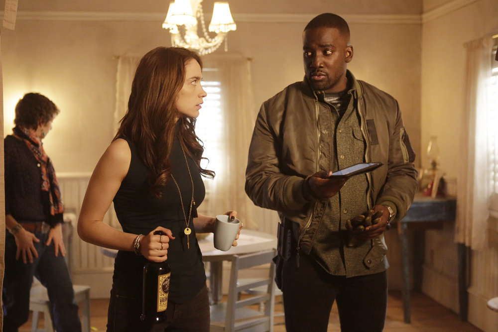 "WYNONNA EARP -- ""Landslide"" Episode 111 -- Pictured: (l-r) Melanie Scrofono as Wynonna Earp, Shamier Anderson as Agent Dolls -- (Photo by: Michelle Faye/Syfy/Wynonna Earp Productions)"