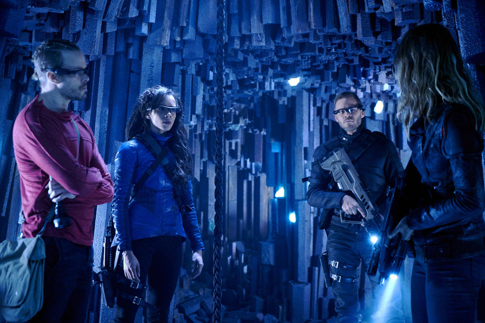 KILLJOYS -- Episode 203 -- Pictured: (l-r) Hannah John-Kamen as Dutch, Aaron Ashmore as John -- (Photo by: Steve Wilkie/Syfy/Killjoys II Productions Limited)