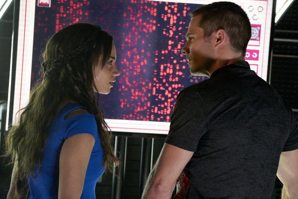 "KILLJOYS -- ""Meet The Parents"" Episode 205 -- Pictured: (l-r) Hannah John-Kamen as Dutch, Luke Macfarlane as D'avin -- (Photo by: Steve Wilkie/Syfy/Killjoys II Productions Limited)"