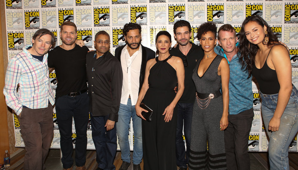 "COMIC-CON INTERNATIONAL: SAN DIEGO -- ""The Expanse Press Room"" -- Pictured: (l-r) Executive Producer Mark Fergus, Wes Chatham, Executive Producer Naren Shankar, Cas Anvar, Shohreh Aghdashloo, Steven Strait, Dominique Tipper, Thomas Jane, Frankie Adams -- (Photo by: Evans Vestal Ward/Syfy)"