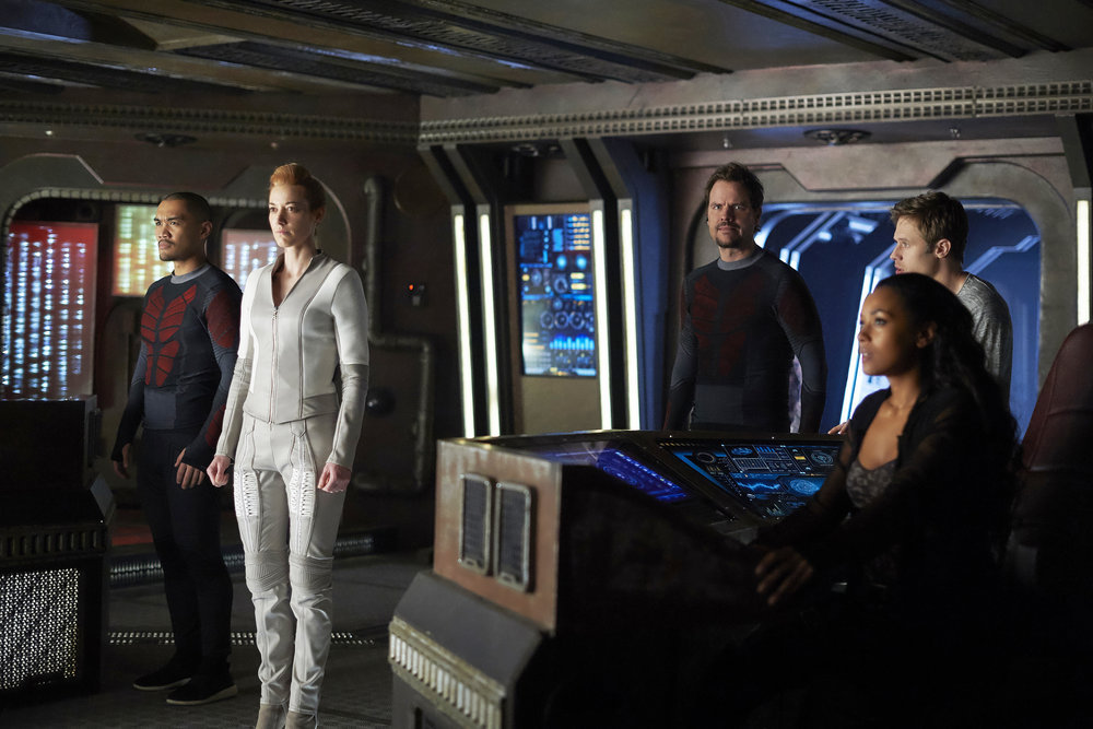 """DARK MATTER -- """"She's One of Them Now"""" Episode 207 -- Pictured: (l-r) Alex Mallari Jr. as Four, Zoie Palmer as The Android, Anthony Lemke as Three , Melanie Liburd as Nyx, Shaun Sipos as Devon -- (Photo by: Russ Martin/Prodigy Pictures/Syfy)"""