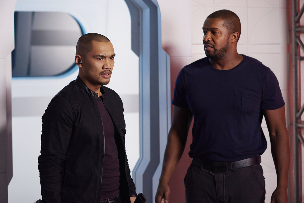 "DARK MATTER -- ""Going Out Fighting"" Episode 209 -- Pictured: (l-r) Alex Mallari Jr. as Four, Roger Cross as Six-- (Photo by: Russ Martin/Prodigy Pictures/Syfy)"