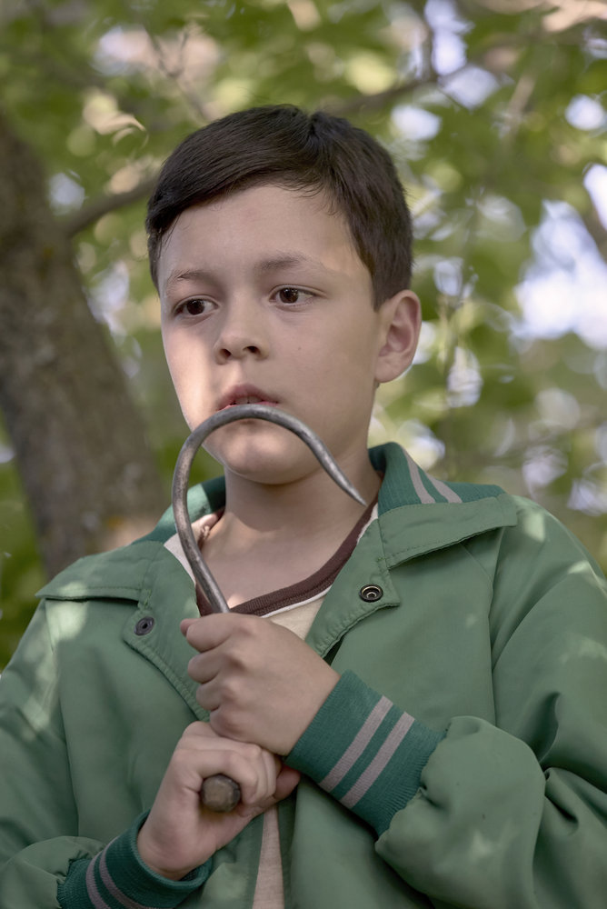 "CHANNEL ZERO: CANDLE COVE -- ""You Have to Go Inside"" Episode 101 -- Pictured: Luca Villacis as Young Mike/Eddie -- (Photo by: Allen Fraser/Syfy)"
