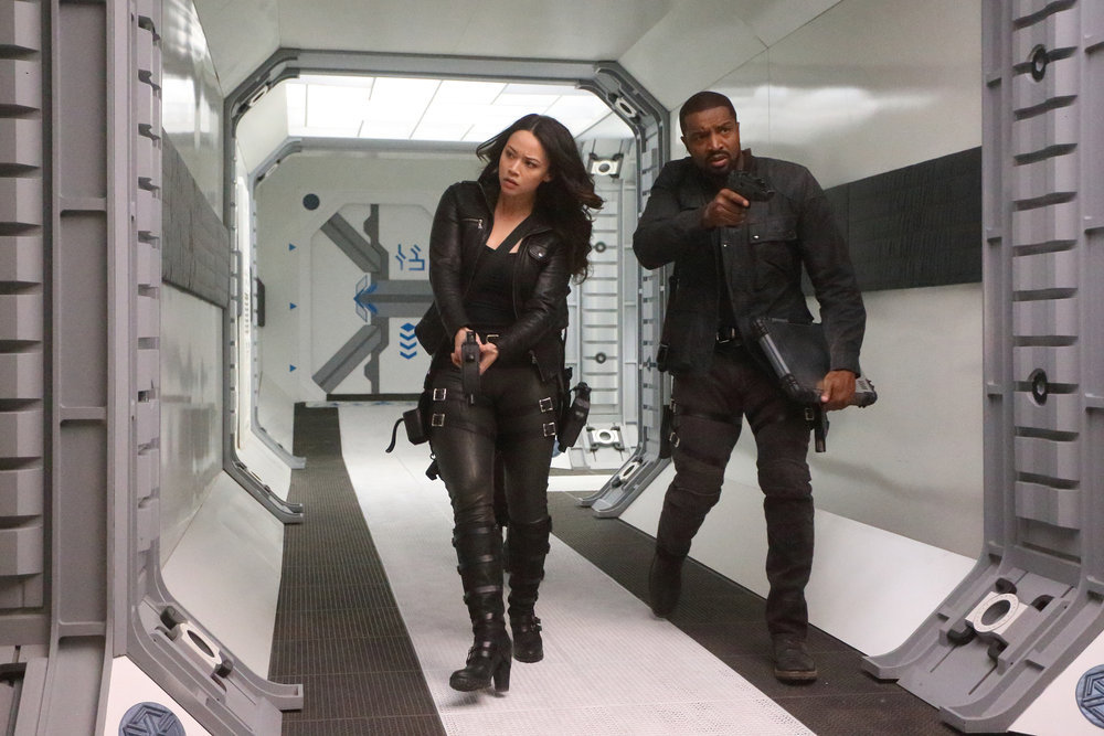 """DARK MATTER -- """"It Doesn't Have To Be Like This"""" Episode 302 -- Pictured: (l-r) Melissa O'Neil as Two, Roger Cross as Six -- (Photo by: Stephen Scott/Dark Matter Series 3/Syfy)"""
