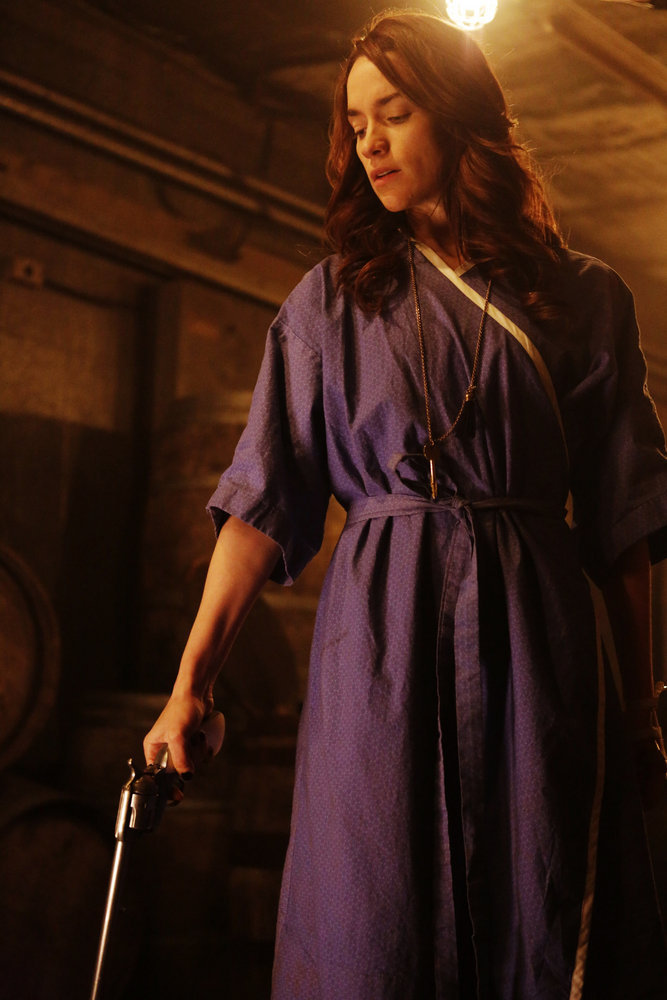"WYNONNA EARP -- ""Two-Faced Jack"" Episode 108 -- Pictured: Melanie Scrofano as Wynonna Earp -- (Photo by: Michelle Faye/Syfy/Wynonna Earp Productions)"