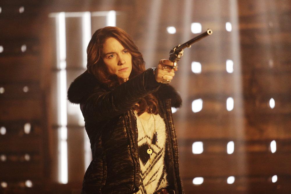 "WYNONNA EARP -- ""Bury Me With My Guns On"" Episode 109 -- Pictured: Melanie Scrofano as Wynonna Earp -- (Photo by: Michelle Faye/Syfy/Wynonna Earp Productions)"