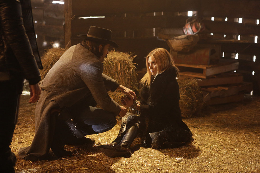 """WYNONNA EARP -- """"Bury Me With My Guns On"""" Episode 109 -- Pictured: (l-r) Tim Rozon as Doc Holliday, Rayisa Kondracki as Constance -- (Photo by: Michelle Faye/Syfy/Wynonna Earp Productions)"""