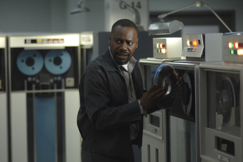 """TIMELESS -- """"Space Race"""" Episode 107 -- Pictured: Malcolm Barrett as Rufus Carlin -- (Photo by: Sergei Bachlakov/NBC)"""