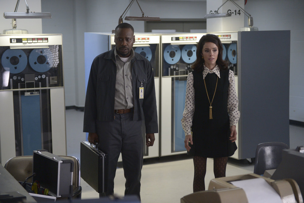"""TIMELESS -- """"Space Race"""" Episode 107 -- Pictured: (l-r) Malcolm Barrett as Rufus Carlin, Abigail Spencer as Lucy Preston -- (Photo by: Sergei Bachlakov/NBC)"""