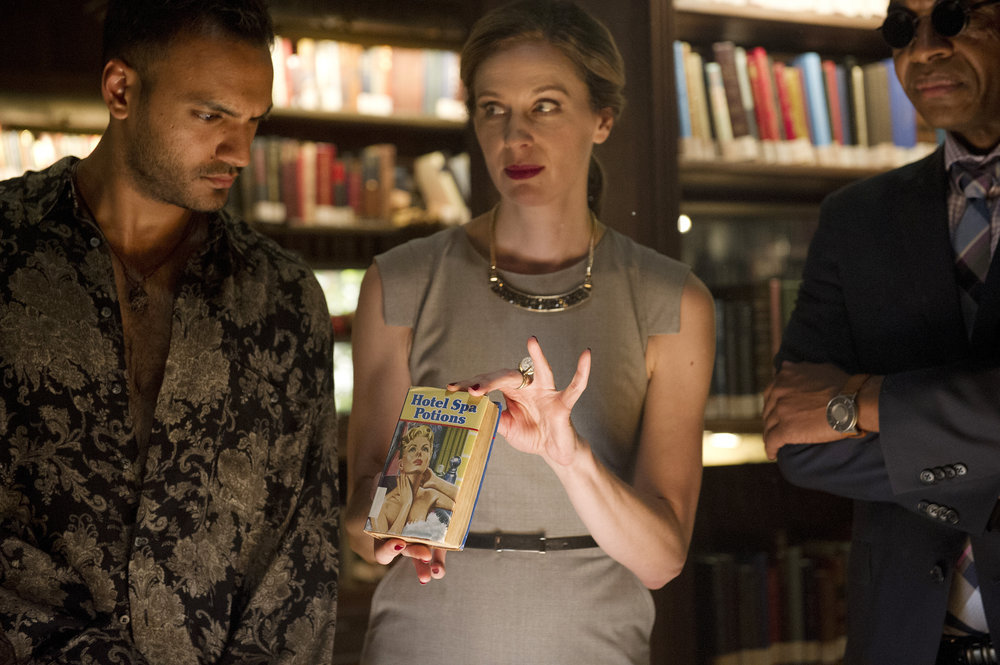 "THE MAGICIANS -- ""Hotel Spa Potions"" Episode 202 -- Pictured: (l-r) Arjun Gupta as Penny, Anne Dudek as Prof. Pearl Sunderland, Rick Worthy as Dean Fogg -- (Photo by: Carole Segal/Syfy)"